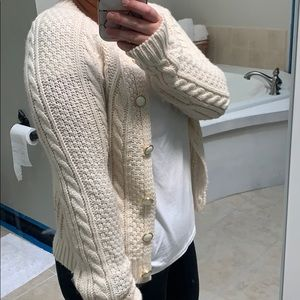 Thick cable knit cardigan.